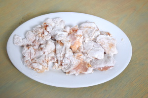 dredge chicken karaage in flour
