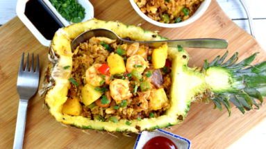 Pineapple fried rice is different from other fried rice because it is the only one cooked with fruits and curry powder. The sweetness of the diced pineapple provides a balance to the savory taste of shrimp and chicken.