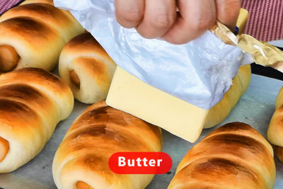 Sausage rolls - apply butter