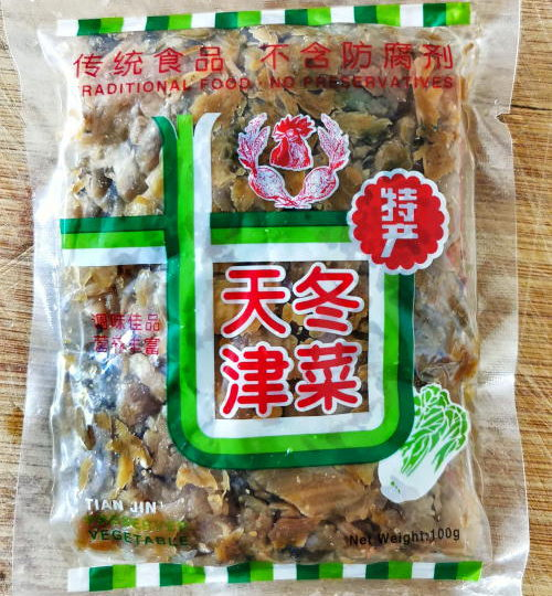 The words 天津冬菜 on the packaging means Tianjin preserved vegetables.  Besides that, it is also called Tianjin winter vegetables, 'tung tsai 冬菜, or Tianjin preserved cabbage.  It is a type of pickled Chinese cabbage originating in Tianjin, China. It is also suitable for stir-fries, stewed dishes, and topping to flavor soups.